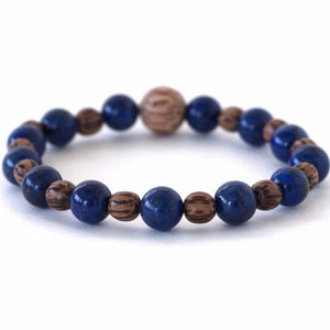 third eye chakra living in the now natural spirit warrior crystal stretch bracelet with lapis lazuli and palm wood beads.