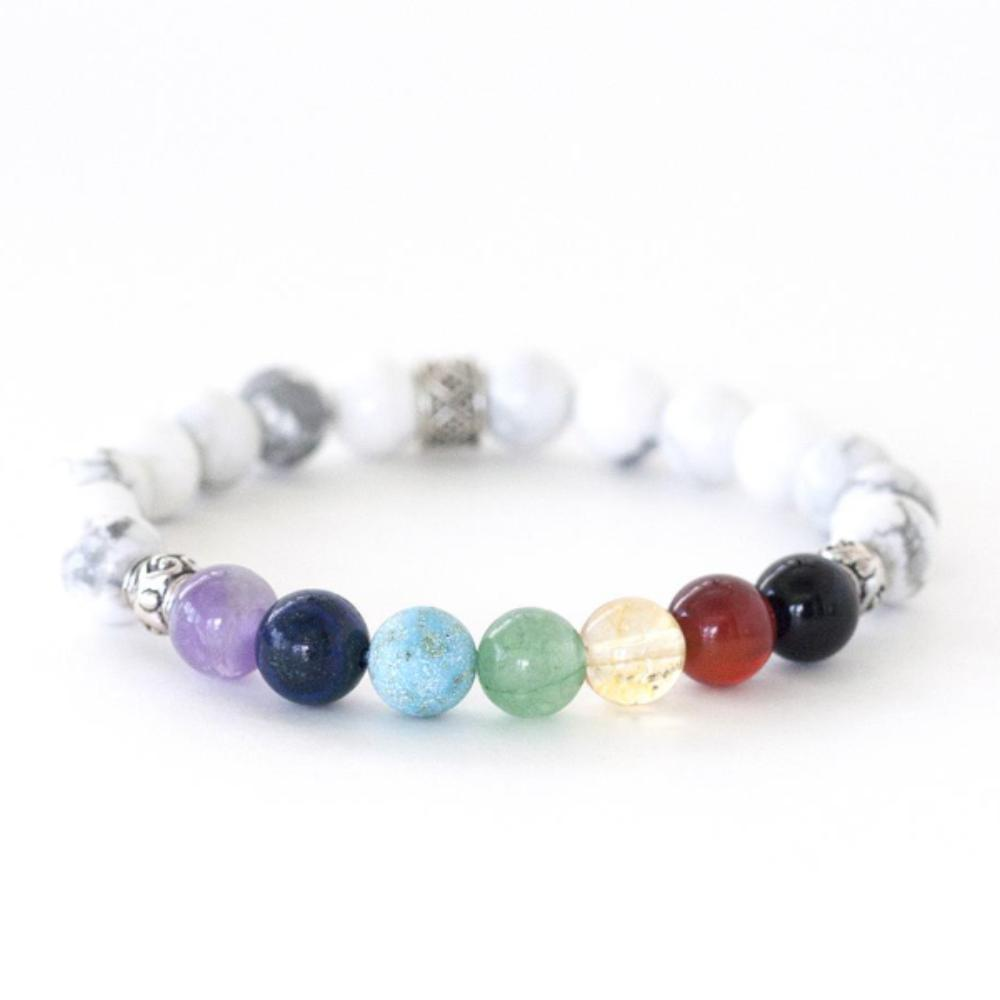 Crystal healing energy bracelet of the seven chakras. Made with natural crystals of amethyst, turquoise, lapis lazuli, citrine, carnelian, black tourmaline and calming howlite.