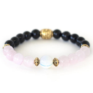 Grieving crystal healing stretch bracelet made of rose quartz, black onyx, and moonstone.