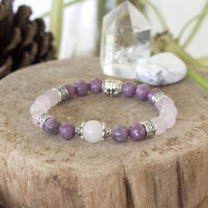 calming crystal energy of rose quartz, lepidolite and opal in this healing stretch bracelet