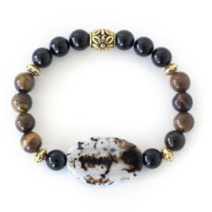 Tigers eye, black onyx and agate healing crystals create this beautiful stretch energy bracelet.