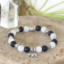 Crystal healing rose quartz, black onyx in a stretch bracelet benefiting the non-profit Save Elephant Organization. Heart Chakra and Root Chakra Energy