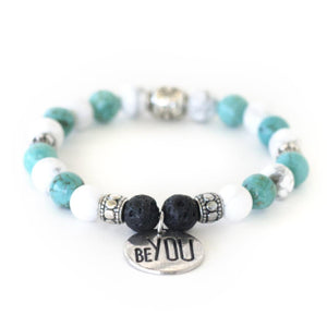 Chakra healing crystal energy of howlite, turquoise and lava stone offer calm and balanced feelings in this stretch crystal gemstone bracelet