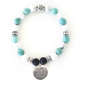 Chakra crystal healing energy of howlite, turquoise and lava stone offer calm and balanced feelings in this stretch crystal gemstone bracelet