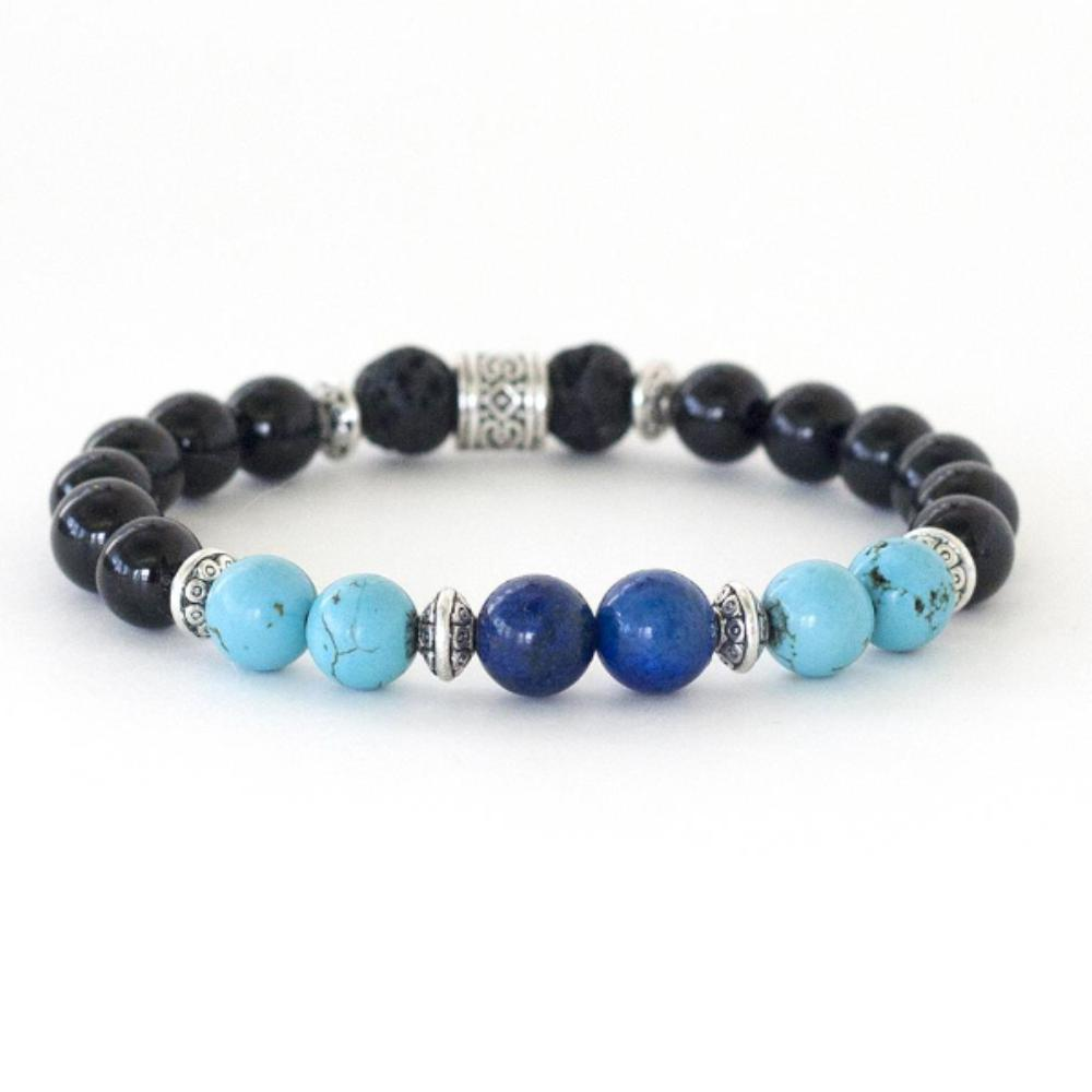 crystal healing energy of lapis lazuli, turquoise, black onyx and lava stone in this healing crystal stretch bracelet.
