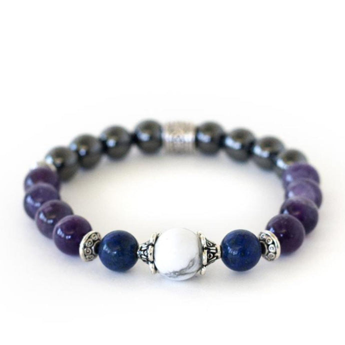 Crystal healing energy stretch bracelet of amethyst, lapis lazuli, howlite and hematite for natural pain relief.