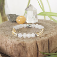 Healing crystals of citrine and white jade in the gorgeous stretch healing bracelet.