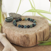 moss agate and black onyx make up this powerful crystal healing stretch bracelet