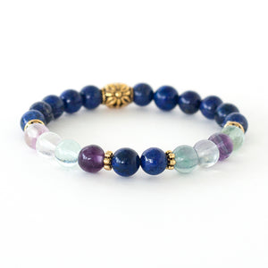 lapis lazuli and fluorite create this crystal healing stretch bracelet
