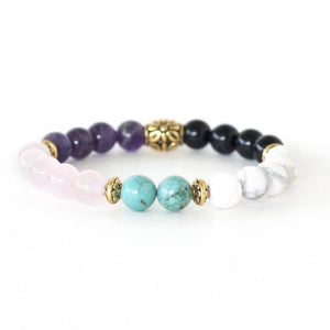 turquoise, rose quartz, howlite, amethyst, and black onyx healing crystals make up this powerful stretch bracelet.