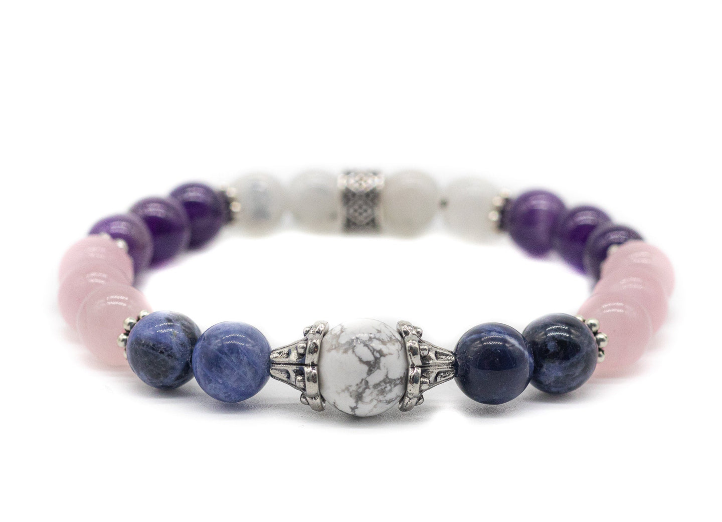 Anti-anxiety crystal bracelet that helps with panic attacks and stress. Made of rose quartz, sodalite, lepidolite, moonstone and hoplite. Product of calmerspirit.com