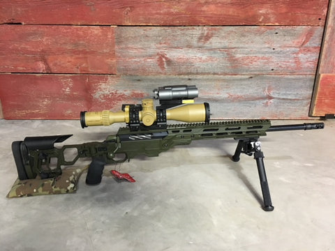 Josh Smith shows off his Cadex sniper rifle and Schmidt & Bender scope at Charlies Custom Clones