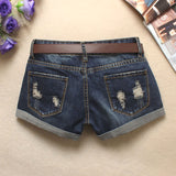 Distressed denim shorts with retro patch
