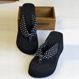 Wedge flip flop sandals with polka dot design