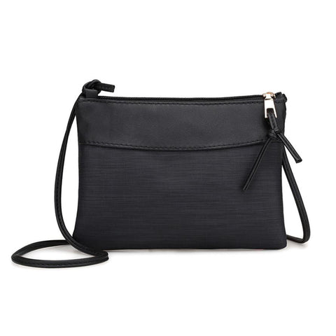 Small hard leather crossbody or shoulder bag removable strap