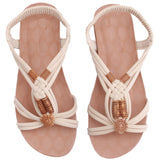 Cross-tied warm weather sandals with plastic flower accent