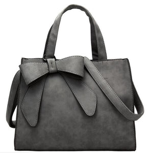 Leather shoulder bag large capacity with bow accent
