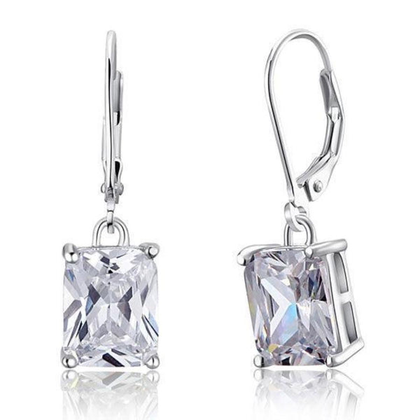 Emerald Cut 4 Carat Sapphire Dangle Earrings.