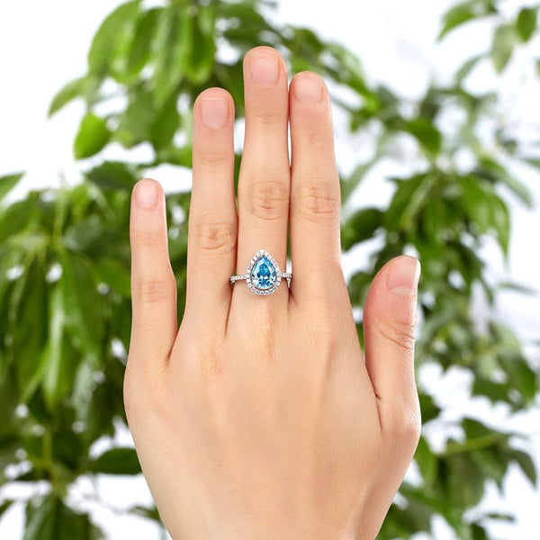 Aqua Pear Cut 2 Carat White Sapphire Bezeled Ring