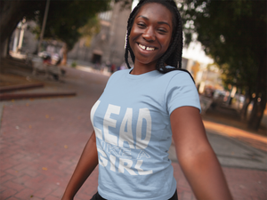 Smiling African American Teen Wearing Light Blue Lead Like A Girl T-shrit