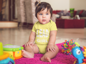 Baby or Toddler Sitting on Play Mat Wearing Yellow Lead Like A Girl Onesie
