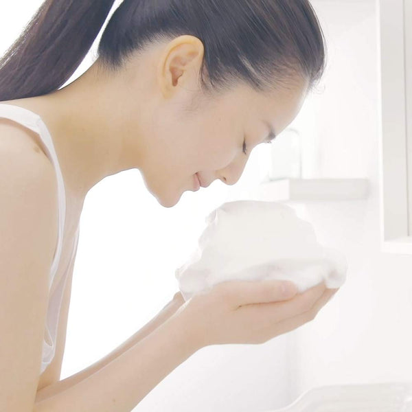 Woman washing her face with the Cucha Soft Wash Sea Mud Facial Cleanser.