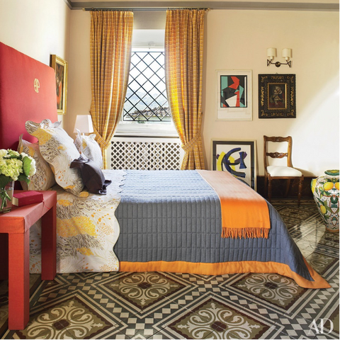 Boho Throw Blankets used on a bed in a bright room