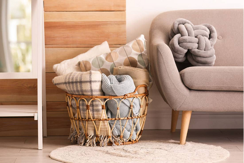 Roll up boho throw blankets and put them in a basket