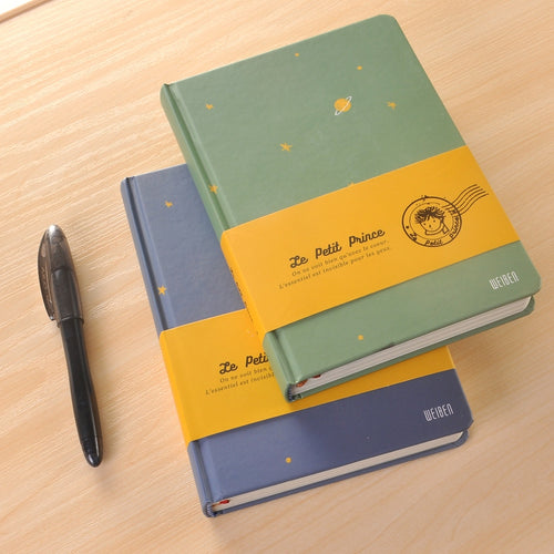 The Little Prince Notebook with colorful background illustrations