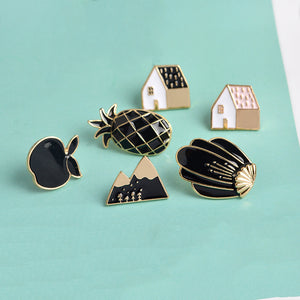 pineapple apple pin set houses mountain and a cactus