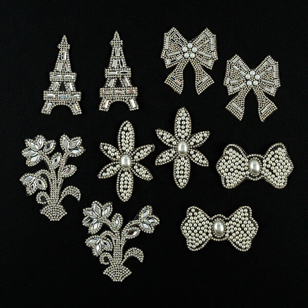 Set of 10 iron on crystal and pearl patches.
