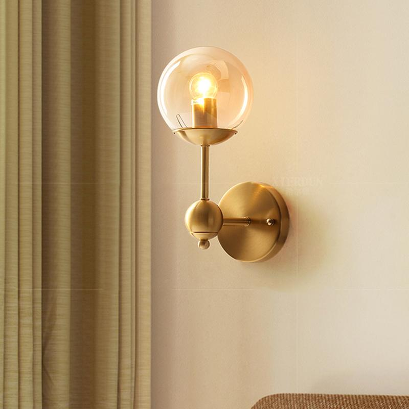 Brass Wall Lamp With Hooded Clear Globe At Living Room