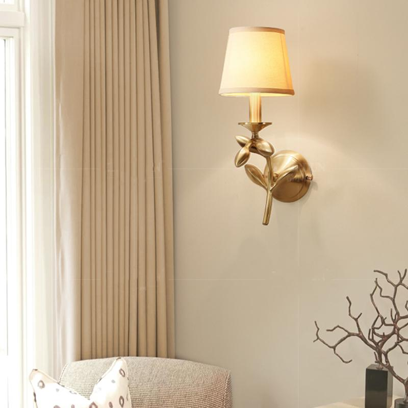 Bina Wall Lamp Brass Finish At Living Room