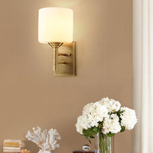 Voca Wall Lamp Brass Finish At Bedroom