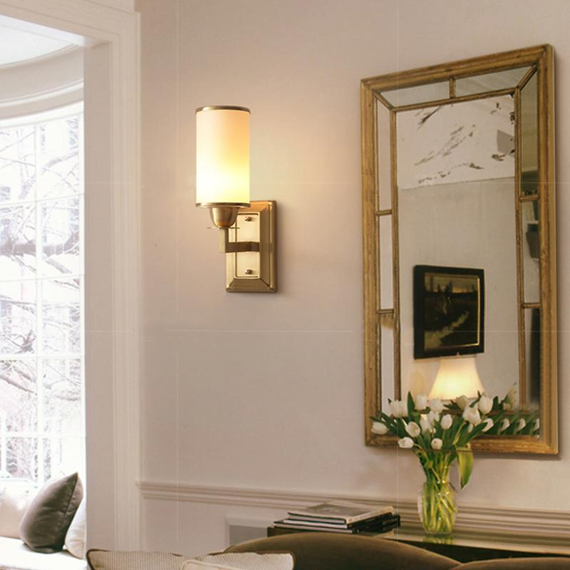 Lin Wall Lamp Brass Finish At Bedroom