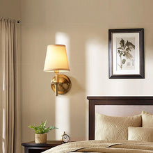 Brass Wall Lamp With Shades At Bed Room