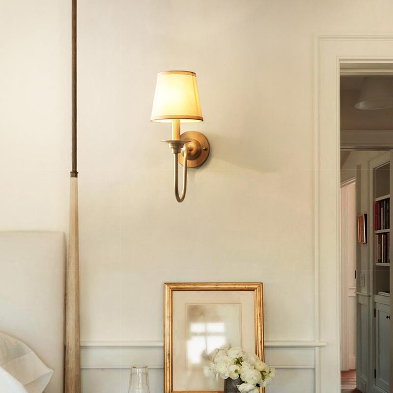 Noi Wall Lamp Brass Finish At Bedroom