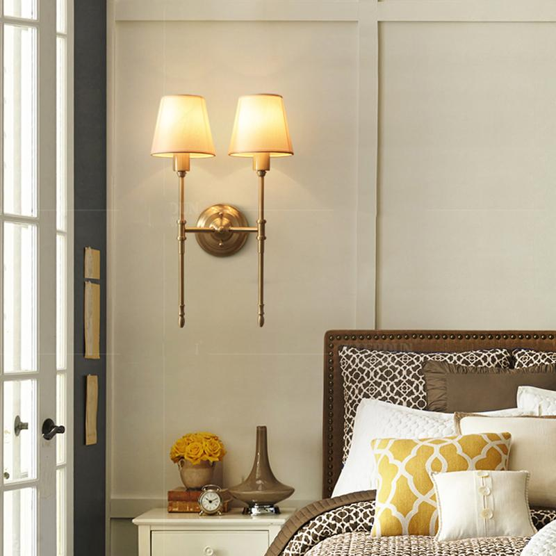 Lop Wall Lamp Brass Finish At Bedroom