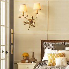 Bina Wall Lamp Brass Finish At Bedroom