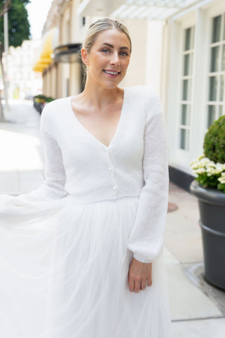 Light wedding jacket with knots in ivory suiting your bridal skirt