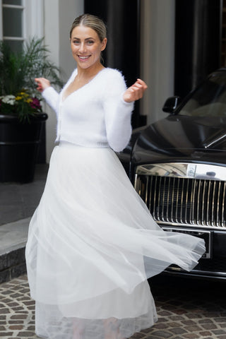 Bride with knit jacket in front of Rollce Royce