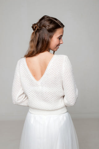 Bridal sweater knitted from cashmere and baby alpaca for the wedding dress