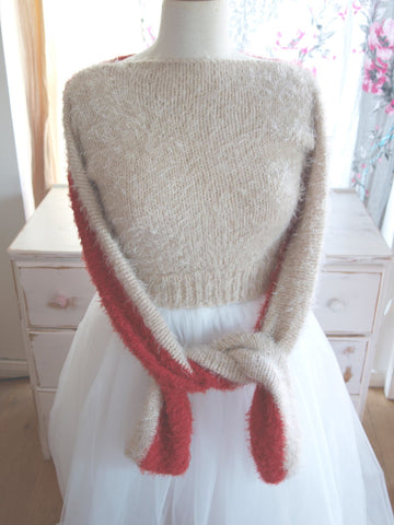 Cuddly sweater knitted in red and brown