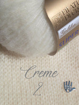 Cashmere wool cream and ivory for a hand-knitted sweater for the bride