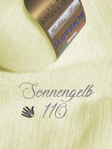 Cashmere wool sun-yellow for a hand-knitted sweater for the bride