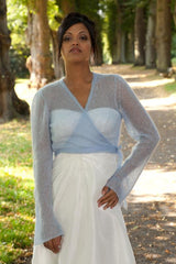 Ice queen look: light blue cardigan and white dress