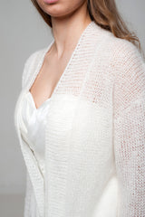 Transparent and delicate bridal jacket made of fine, soft wool