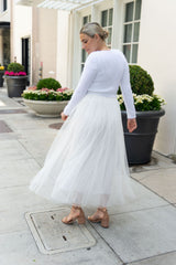 Ivory tulle skirt for the bride with a knitted jacket