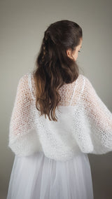 Bridal bolero knitted from soft wool in ivory and white