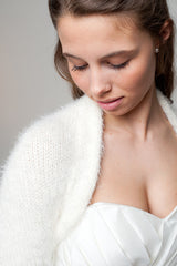 Bridal bolero made of soft wool for the wedding dress knitted in ivory and white